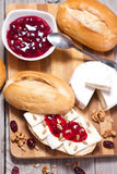 Bread served with camembert and cranberry. Stock Images