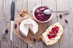 Bread served with camembert and cranberry. Stock Image