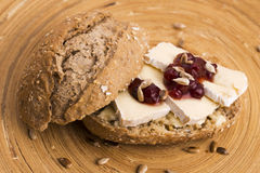 Bread served with camembert and cranberry Stock Photos