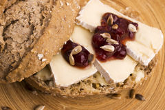 Bread served with camembert and cranberry Royalty Free Stock Photo