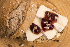 Bread served with camembert and cranberry Stock Images
