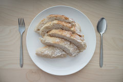 Bread served on white table with fork and spoon Royalty Free Stock Photography