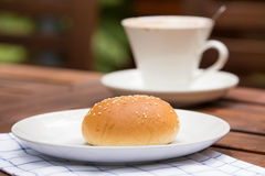 Bread with sesame seeds and coffee Stock Images