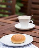 Bread with sesame seeds and coffee. Royalty Free Stock Photo