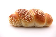 Bread with sesame on white background. Royalty Free Stock Photography