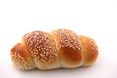 Bread with sesame on white background. Stock Photos