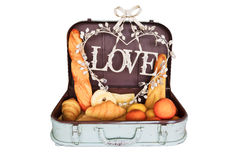 Bread set in travel luggage with love on white Stock Images