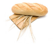 Bread and several wheatear on  cutting board Royalty Free Stock Photography
