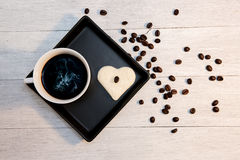 Bread in shape of heart with cup of coffee Stock Photo
