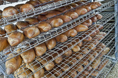 Bread on shelves. Wired rack filled with fresh baked bread Stock Photography