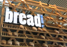 Bread on shelves. Pieces of bread on wooden shelves with the word BREAD Royalty Free Stock Photography