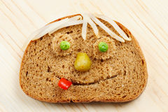 Bread slice as smiling face Stock Photo