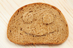 Bread slice as smiling face Royalty Free Stock Photography