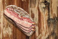 Bread Slice with Bacon Rashers on Old Wooden Background Stock Photos