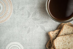 Bread slice and a cup of coffee Royalty Free Stock Photography
