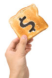 Bread slice with dollar sign Royalty Free Stock Photo