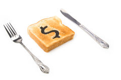 Bread slice with dollar sign Stock Photo