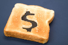 Bread slice with dollar sign Royalty Free Stock Photography
