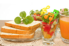 Bread slice and fruit salad with orange juice fusion food Stock Photography