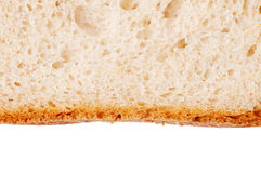 Bread slice with golden crust Stock Photos