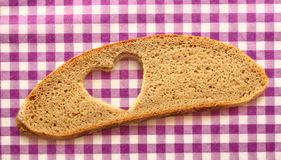 Bread slice and heart cut Royalty Free Stock Image
