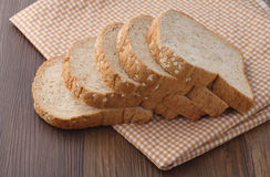 Bread Slice On Wooden Table Royalty Free Stock Image