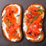 Bread slice with salmon. Bread slice with cheese and smoked salmon Stock Images