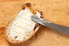 Bread. A slice of bread spread with butter Stock Image