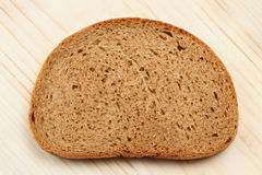 Bread slice on table Royalty Free Stock Image