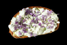 Bread slice with white spread, violet flowers Royalty Free Stock Photos