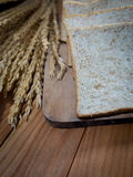 Bread slice. On wood table Royalty Free Stock Photo