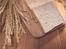 Bread slice. On wood table Royalty Free Stock Photos