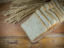 Bread slice. On wood table Royalty Free Stock Images