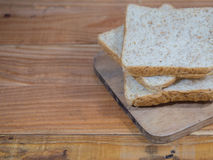 Bread slice. On wood table Royalty Free Stock Image