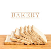 Bread slice on wooden table isolated in white background Stock Photography