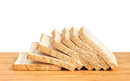 Bread slice on wooden table isolated in white background Royalty Free Stock Photography