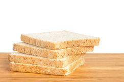 Bread slice on wooden table isolated in white background Stock Image