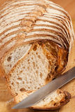 Bread. Sliced bread on a wooden board Royalty Free Stock Images