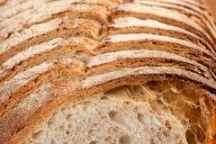 Bread. Sliced bread on a wooden board Stock Photos