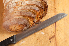 Bread. Sliced ​​bread on a wooden board Royalty Free Stock Photos
