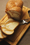 Bread sliced on the cutting board. Unusual marble bread cutted on simple rural styled cutting board stock photography