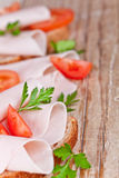 Bread with sliced ham, fresh tomatoes and parsley Stock Photography