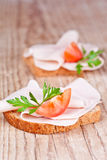 Bread with sliced ham, fresh tomatoes and parsley Royalty Free Stock Images