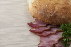 Bread and sliced ham Stock Images