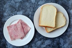 Bread with sliced pork ham Stock Images