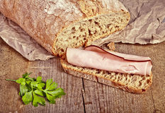 Bread with sliced pork ham close up Stock Photo