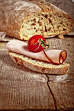 Bread with sliced pork ham close up Stock Images