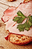 Bread with sliced pork ham close up Stock Image