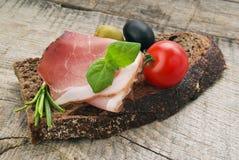 Bread with sliced pork ham Stock Photos