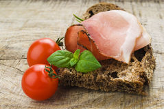 Bread with sliced pork ham Stock Photography